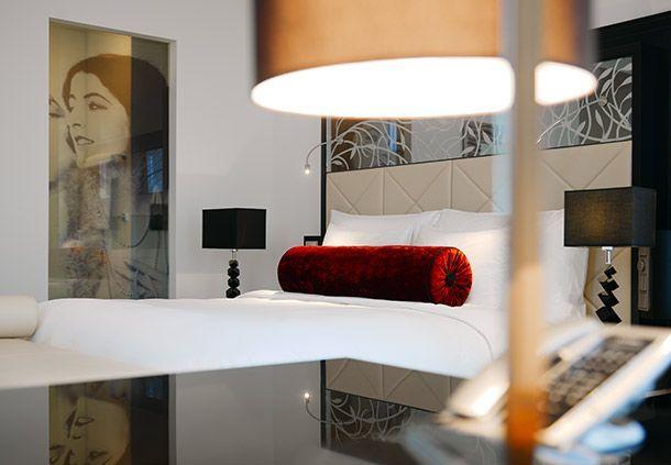 Tête de lit dans une chambre du Am Steinplatz hôtel